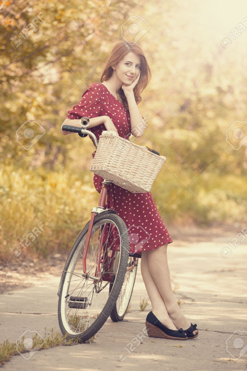 Beautiful girl with bike at countryside. Vintage. Stock Photo - 19583761