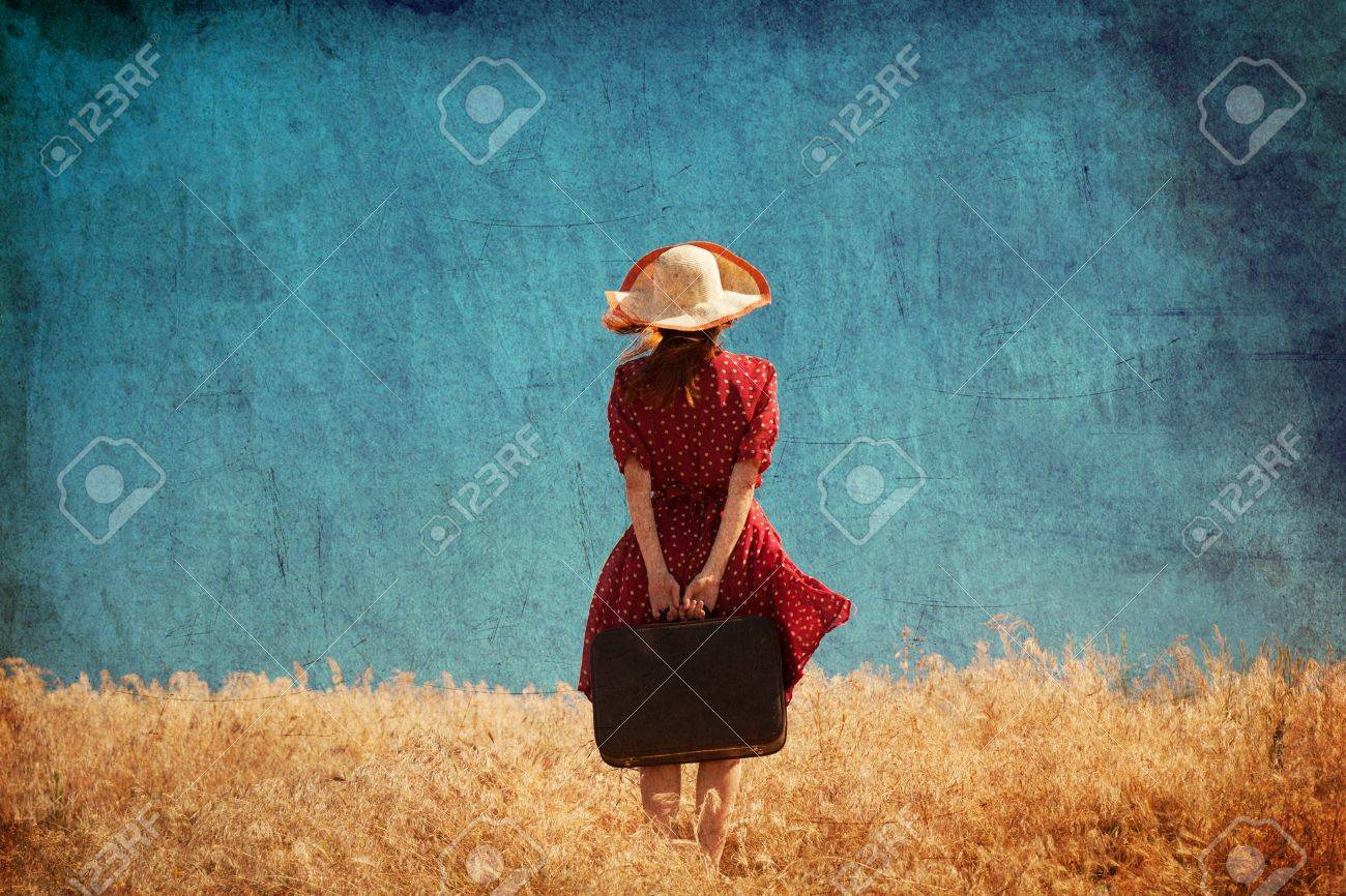 Redhead girl with suitcase at summer field. Stock Photo - 19915467
