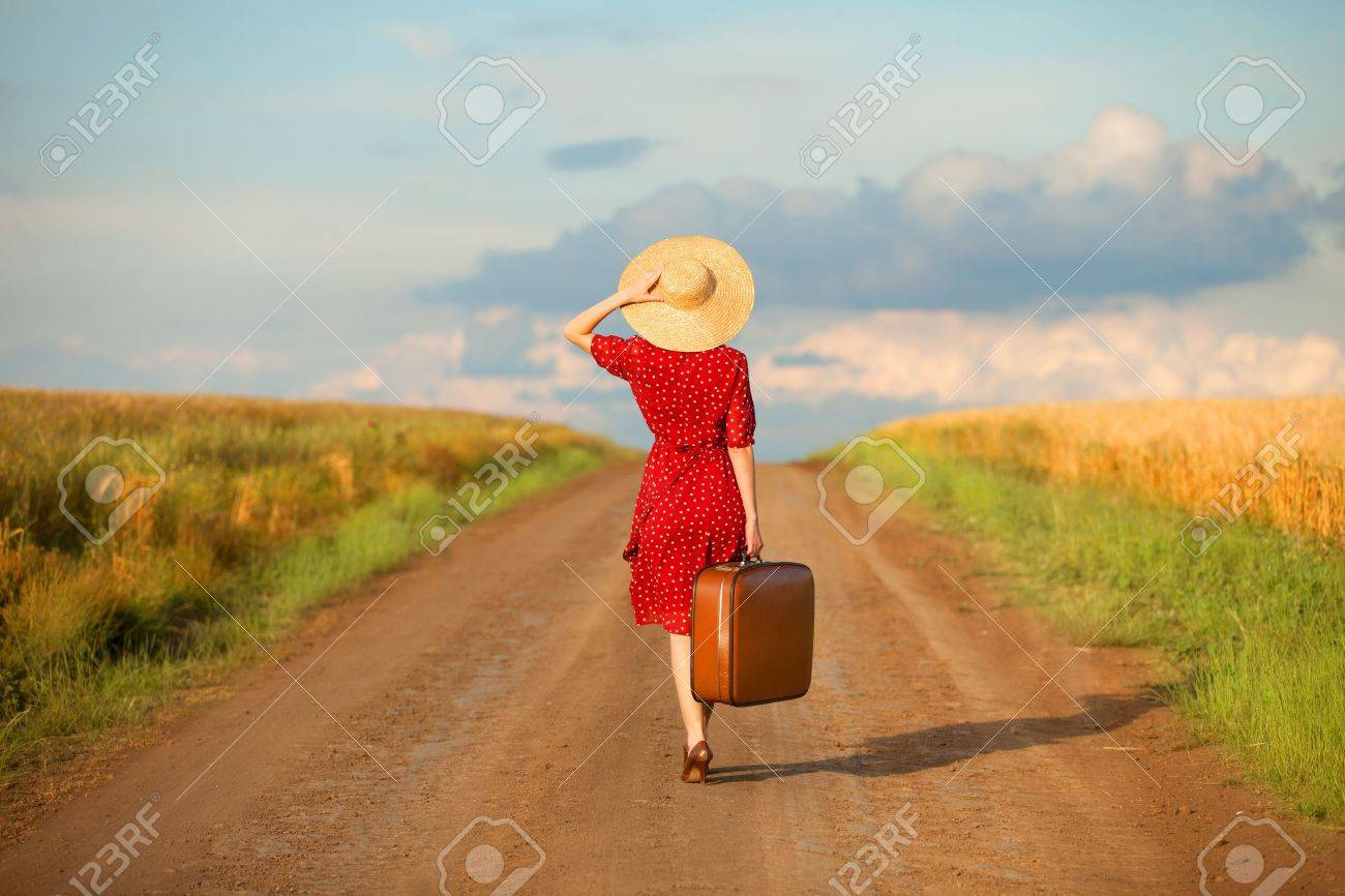 Redhead girl with suitcase at outdoor. Stock Photo - 20251387