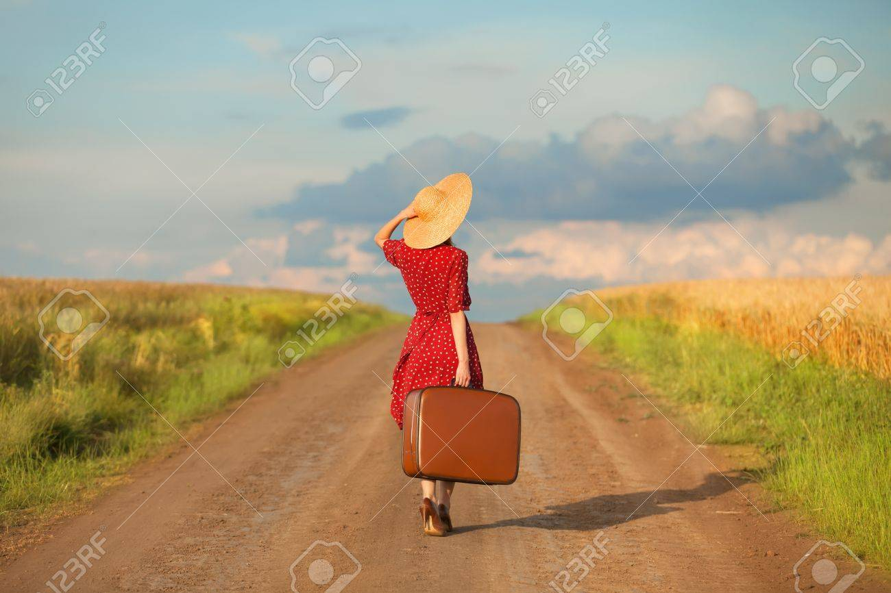 Redhead girl with suitcase at outdoor. Stock Photo - 20261094