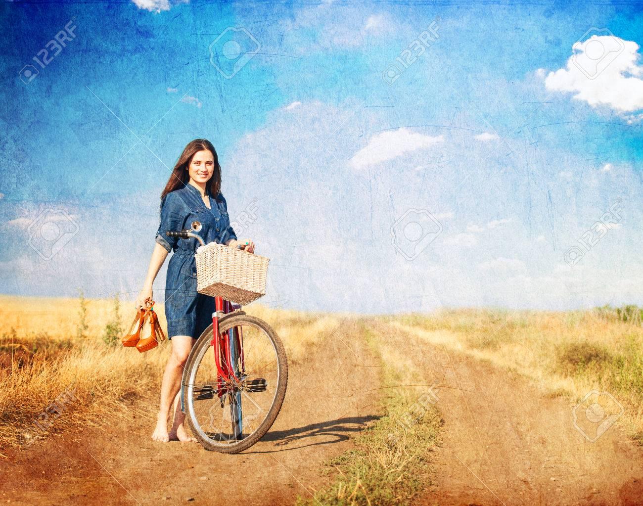 https://previews.123rf.com/images/massonforstock/massonforstock1407/massonforstock140700006/29793441-brunette-girl-with-bycicle-on-countryside-road-.jpg