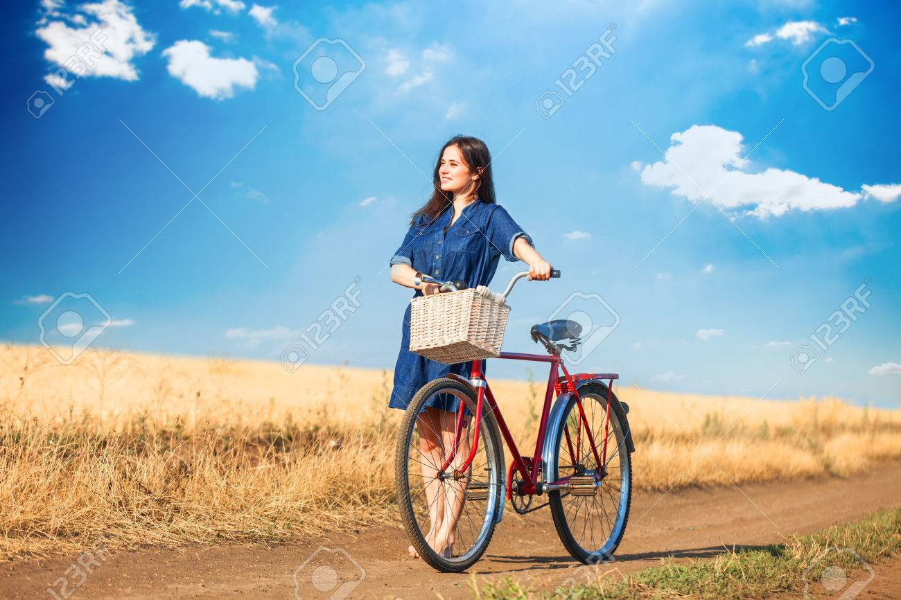 https://previews.123rf.com/images/massonforstock/massonforstock1407/massonforstock140700007/29793443-brunette-girl-with-bycicle-on-countryside-road-.jpg