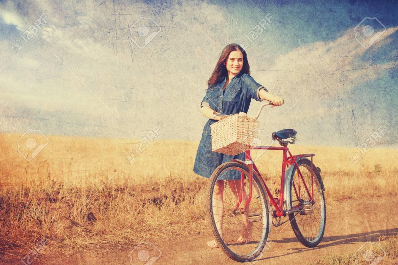 https://previews.123rf.com/images/massonforstock/massonforstock1407/massonforstock140700026/29793481-brunette-girl-with-bycicle-on-countryside-road-.jpg