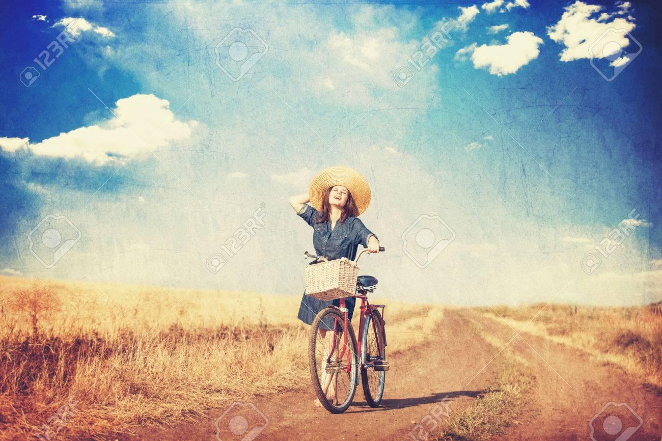 https://previews.123rf.com/images/massonforstock/massonforstock1407/massonforstock140700027/29793482-brunette-girl-with-bycicle-on-countryside-road-.jpg