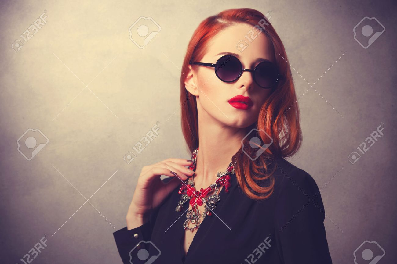 Portrait of a style redhead women Stock Photo - 32994768