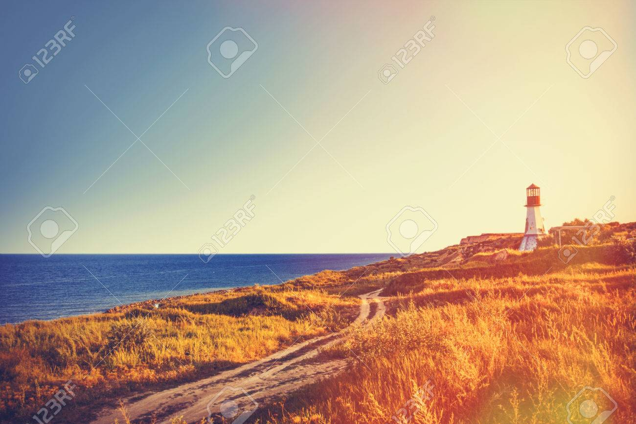 View on old lighthouse near a sea in autumn time - 43008596