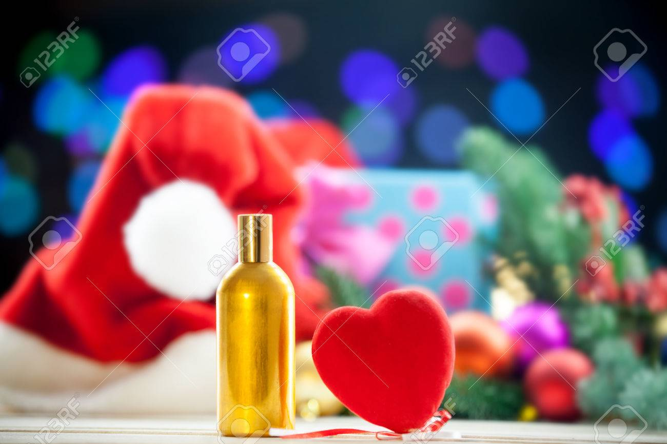 heart shape toy and perfume bottle on christmas lights background stock photo 45825351