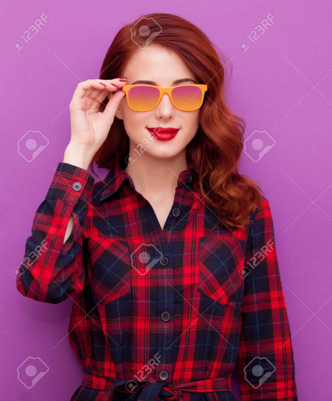 Redhead girl in sunglasses on violet background - 46650128
