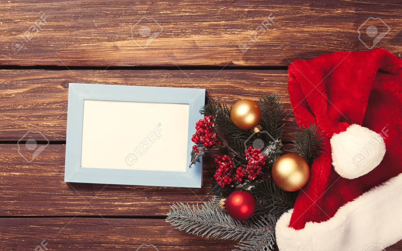 Photo Frame And Christmas Gifts On Wooden Background Stock Photo ...