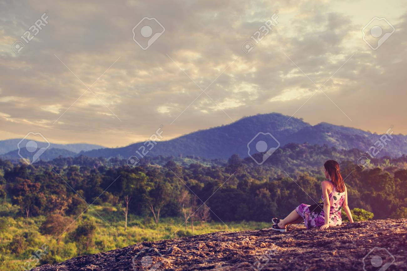 Young woman looking on a mountain landscape - 51938342