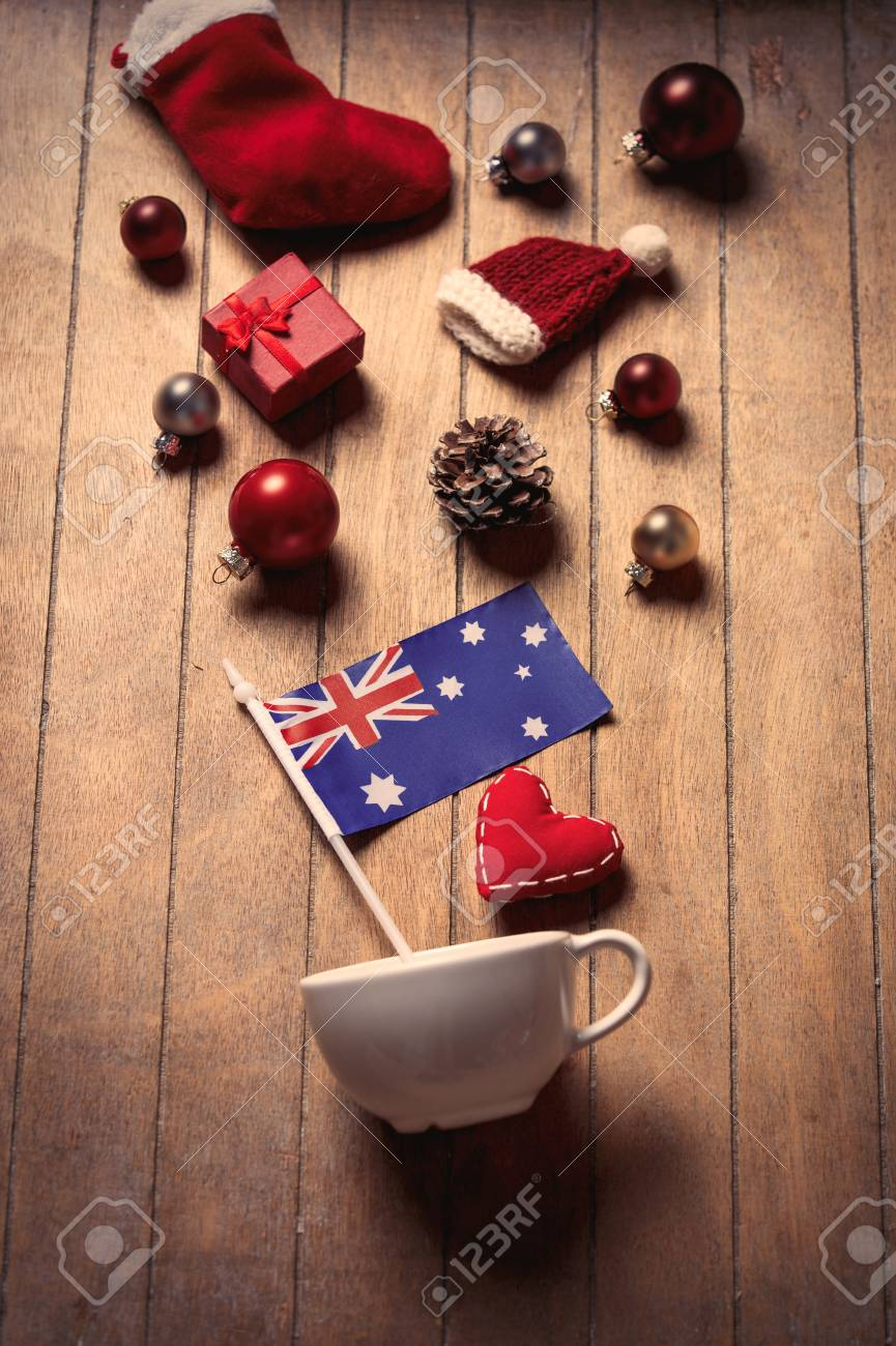 White Cup And Australia Flag With Christmas Decoration On Wooden