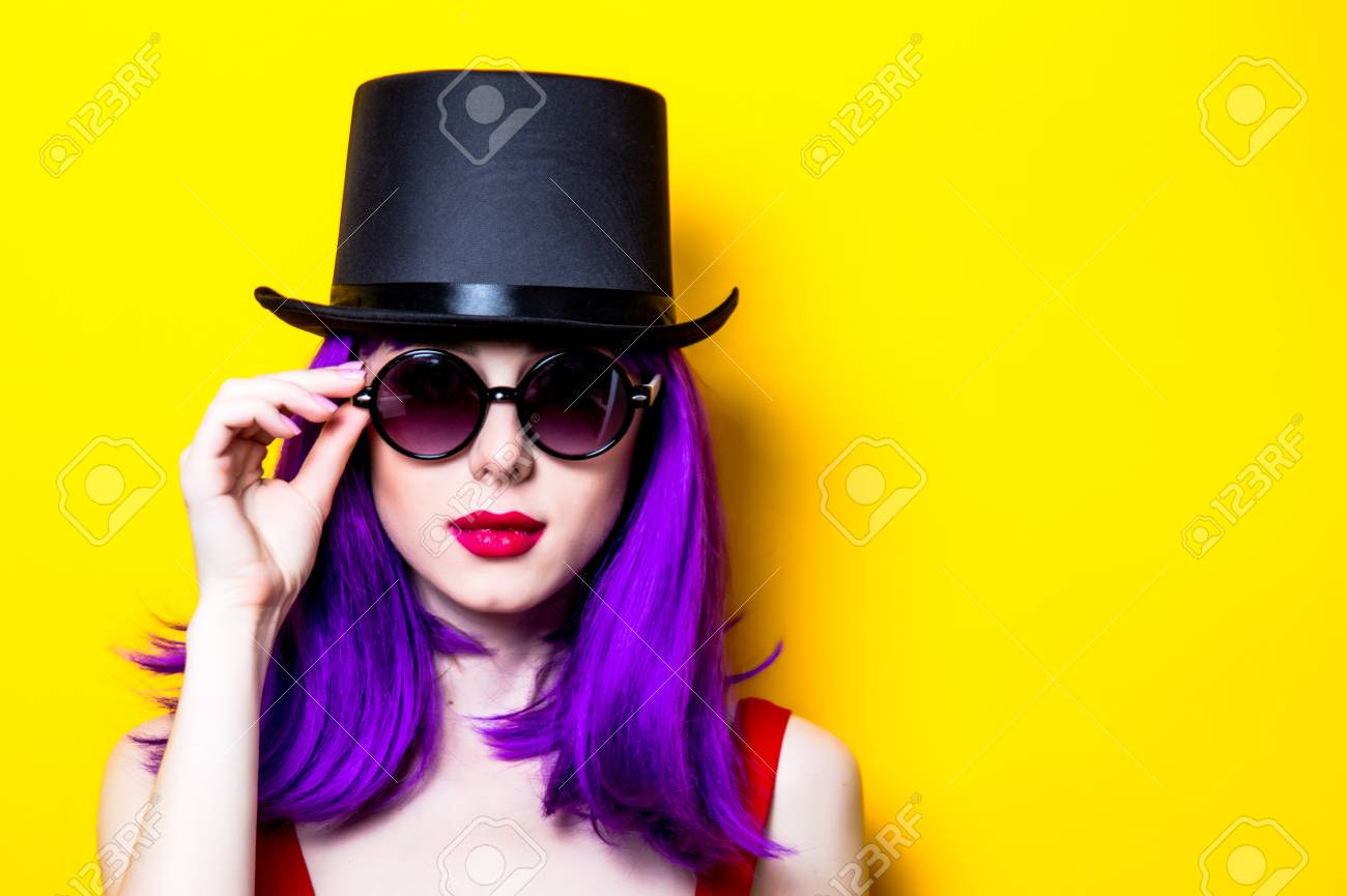 Portrait Of Young Girl With Purple Color Hair And Top Hat On