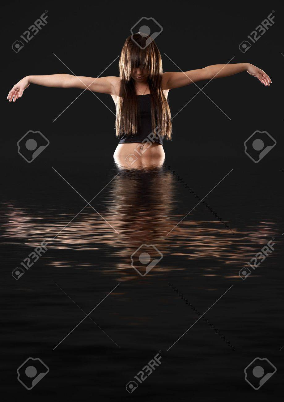 Woman emerging from water Stock Photo - 793206