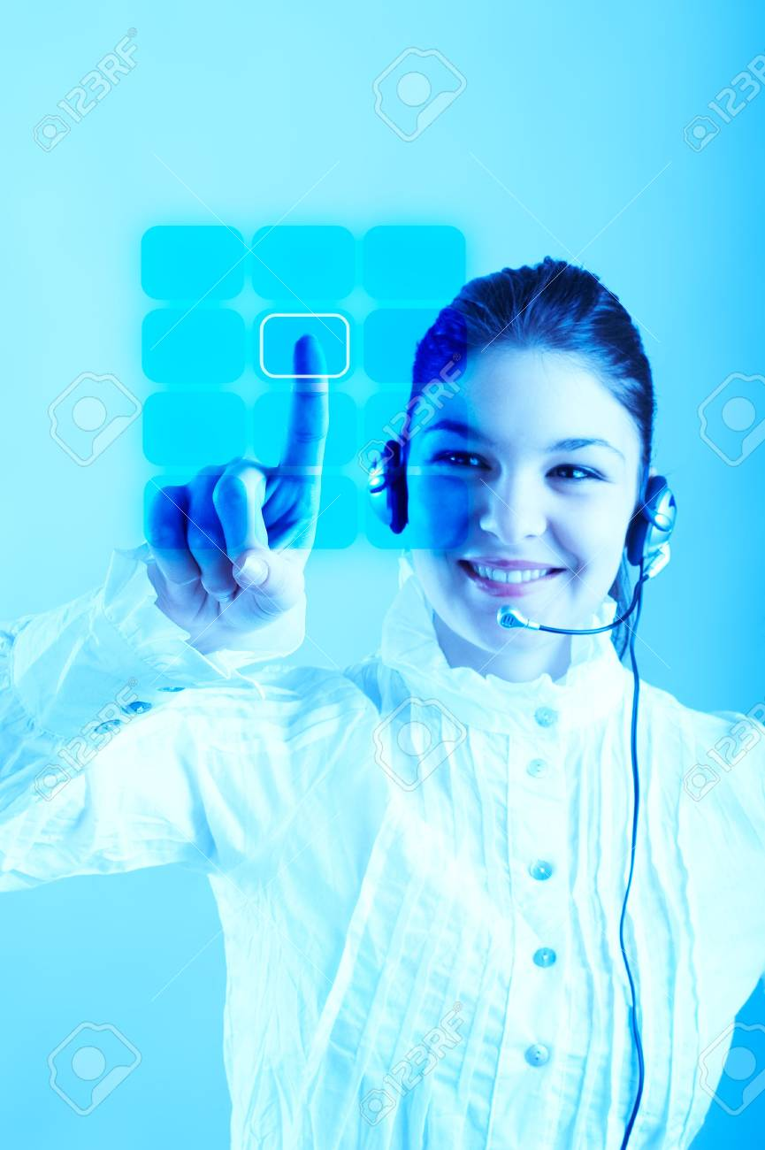 Beautiful Customer Representative with headset smiling during a telephone conversation entering a code on a virtual keyboard Stock Photo - 804395
