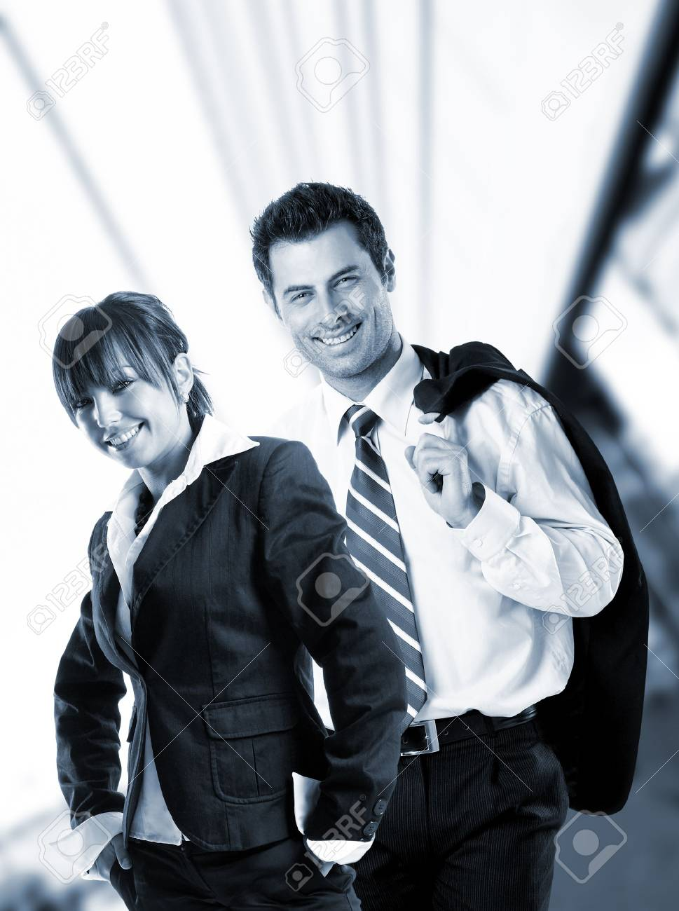 Attractive business people in front of a glass building - check my portfolio for similar photos Stock Photo - 1149402