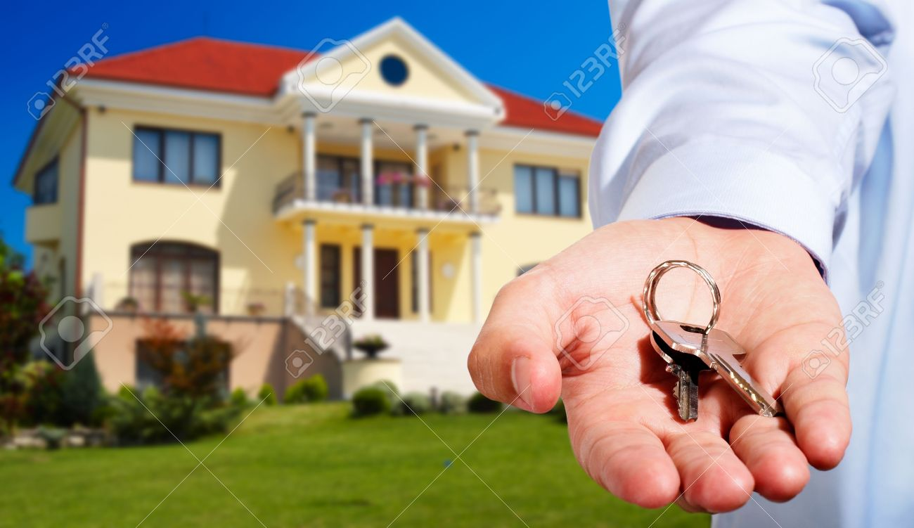 Wonderful House Owner/real Estate Agent Giving Away The Keys   House Out Of Focus  Stock