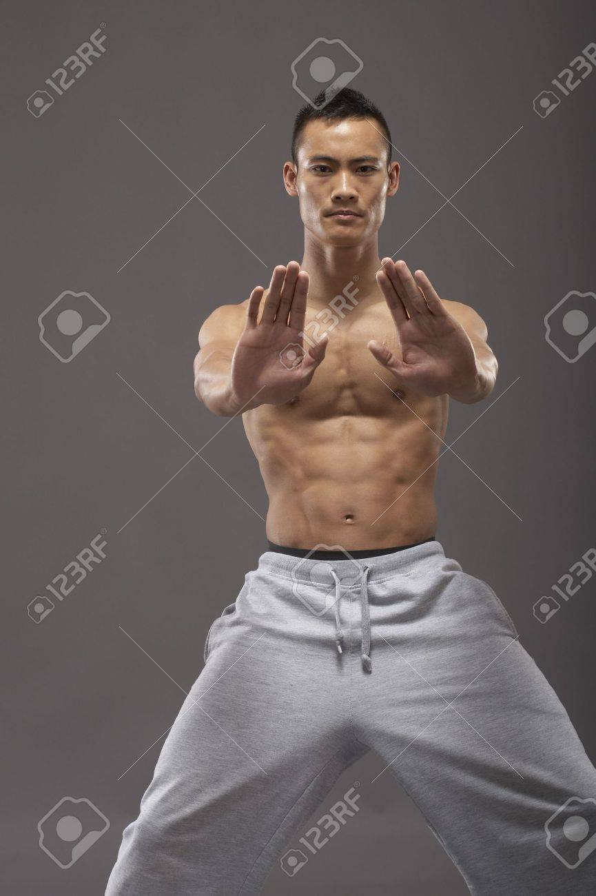 Young asian martial arts man over gray background Stock Photo - 3112002