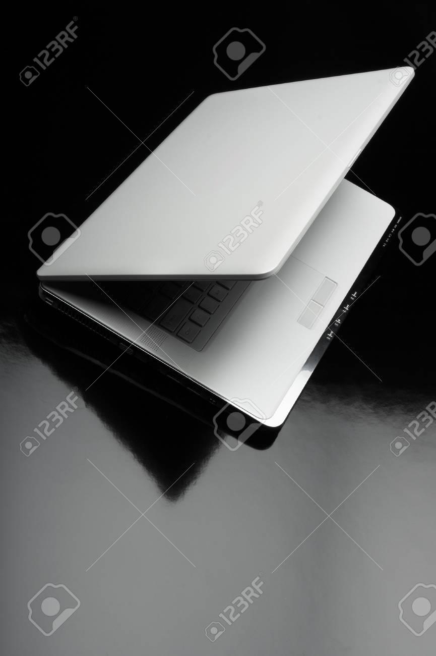 Laptop shot on reflective table Stock Photo - 4192659