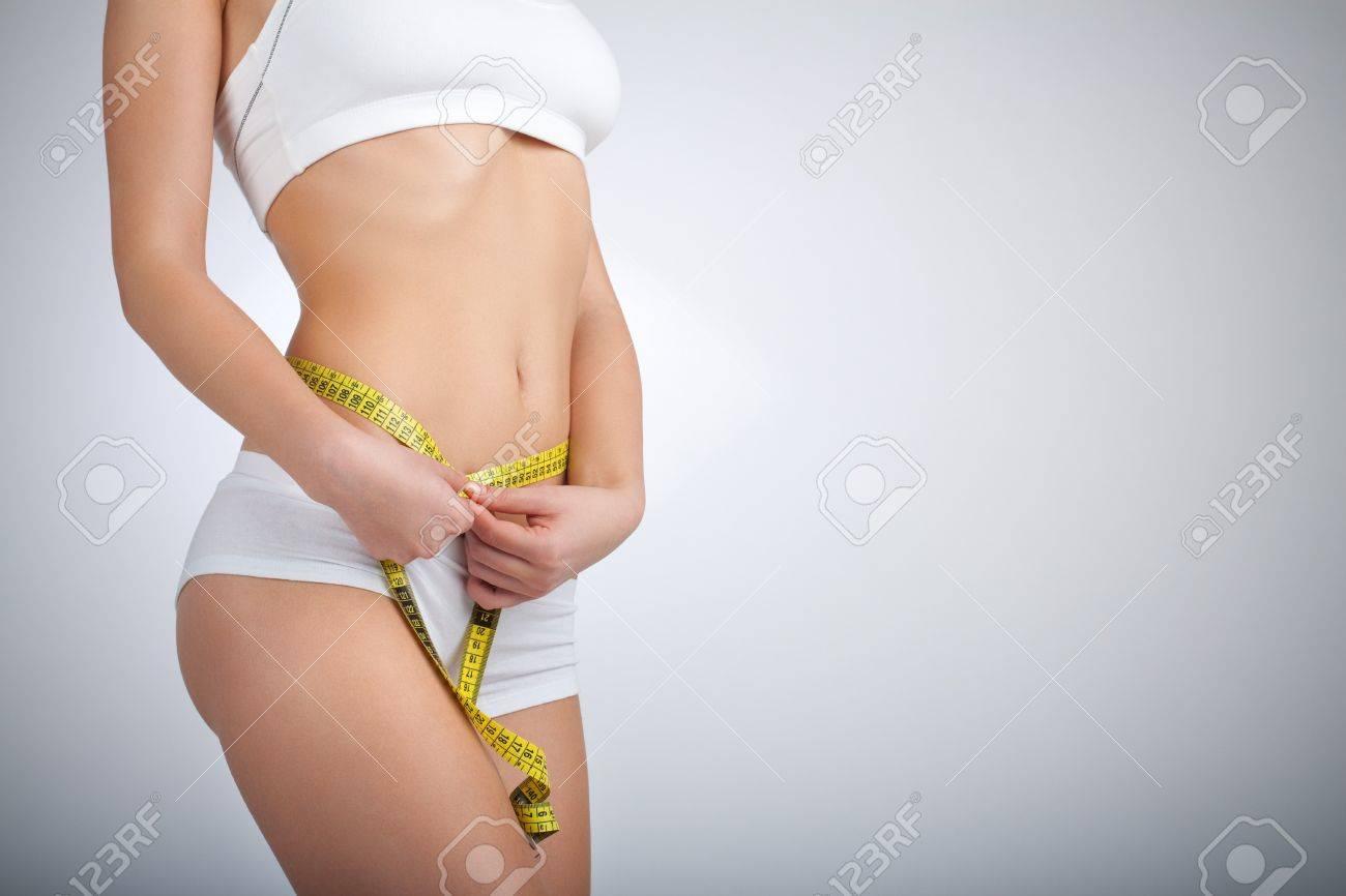 Woman measuring her waist - 4240854