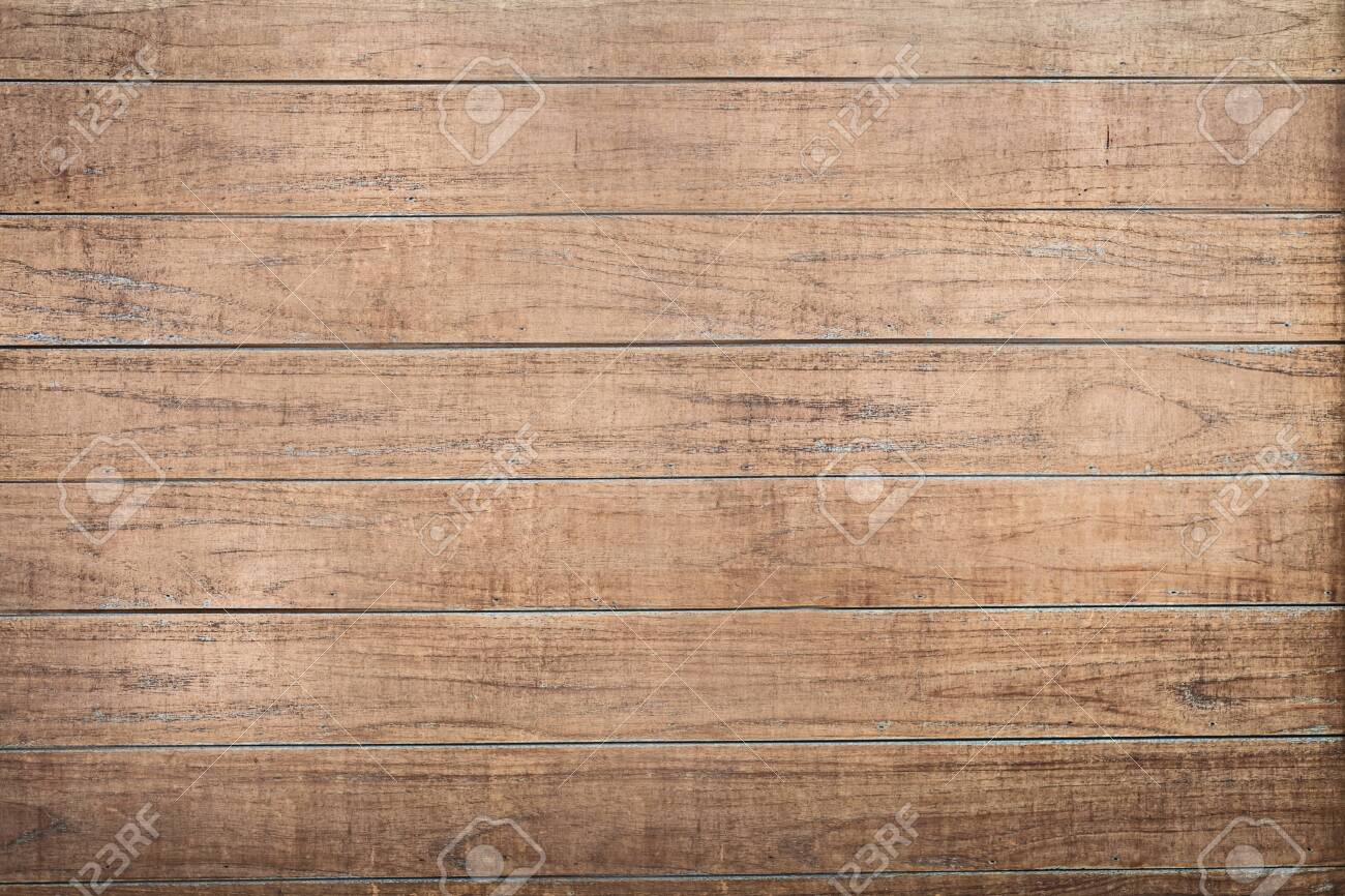 The wall of the house is covered with brown wooden boards .Texture or background - 135717226