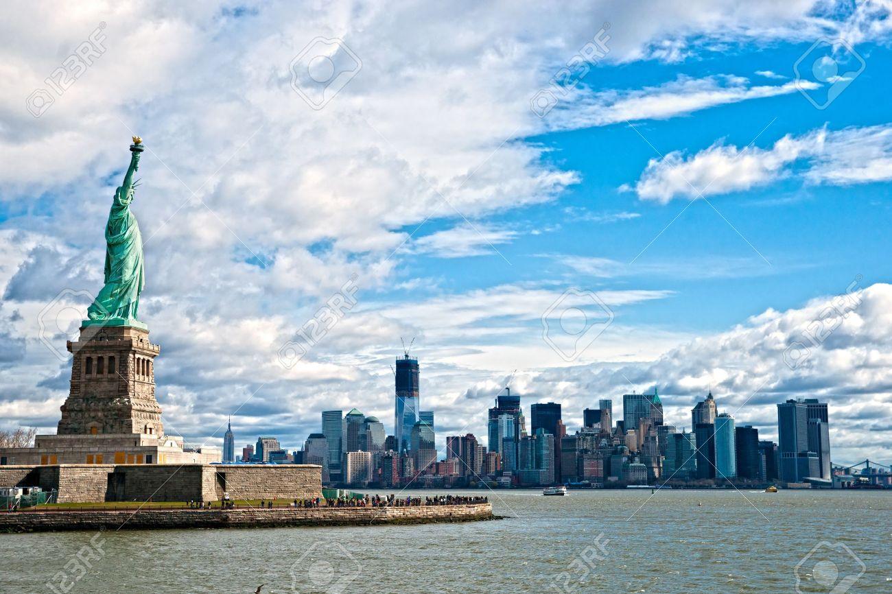 the statue of liberty and manhattan skyline new york city usa