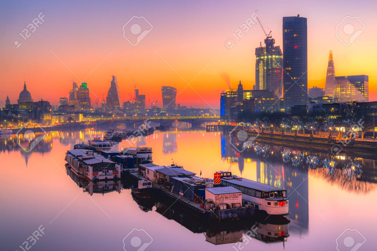 City of London skyline at sunrise with St  Paul basilica and