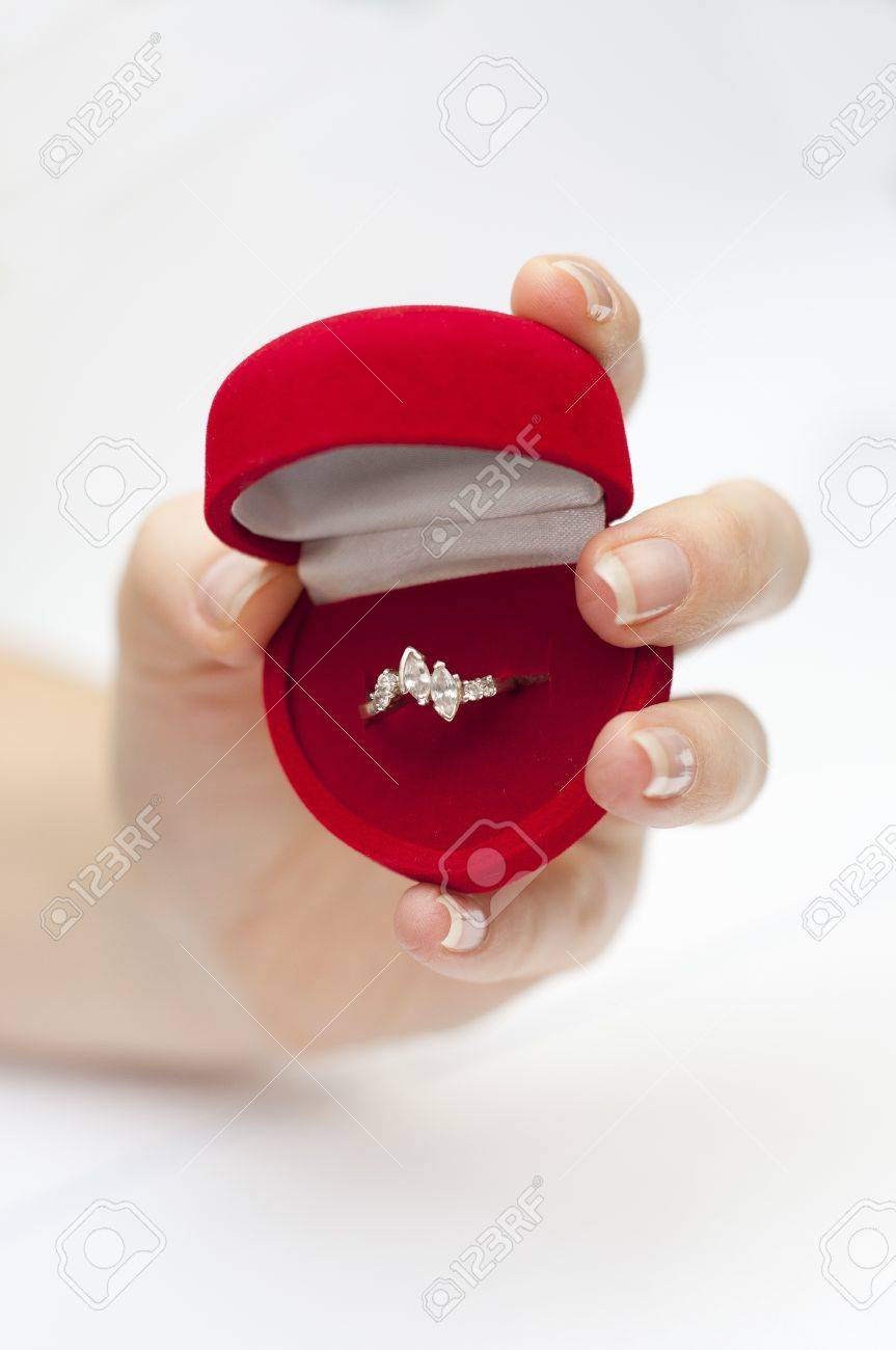 an image of red box with engagement ring inside held in hand Stock Photo - 8840249