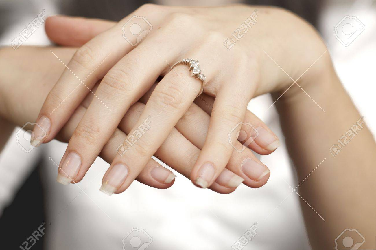 an image of engagement ring inserted into finger Stock Photo - 8840250