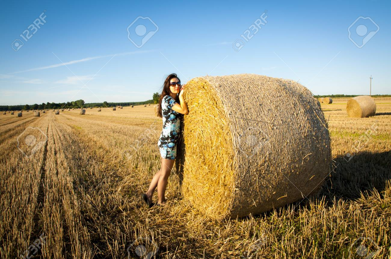 An image of brunette girl portrait and straw bale Stock Photo - 16232277