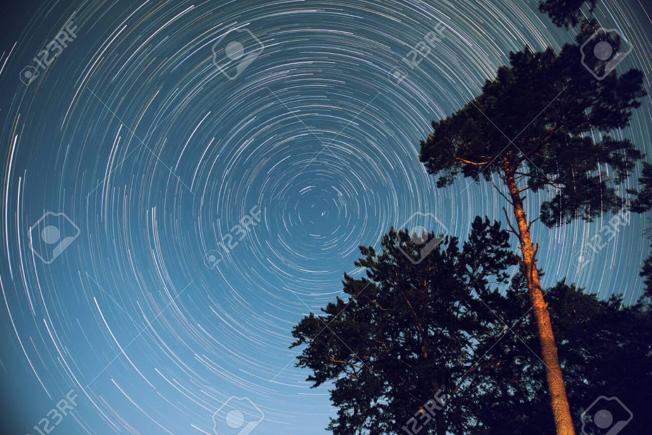 A photograph of a startrails in the sky under the starry sky - 131643445