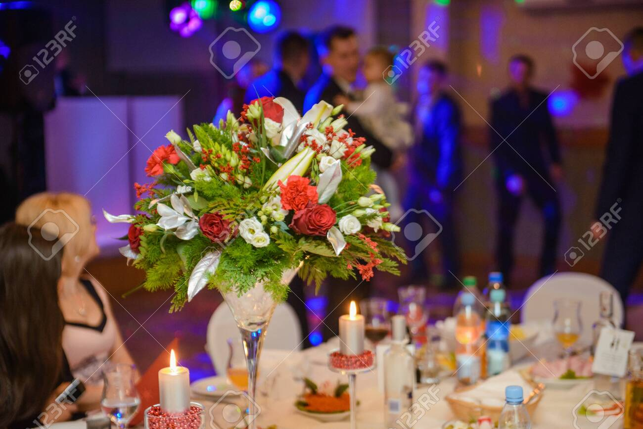 Beautifully decorated wedding table and other details at wedding hall. Wedding day - 135957117