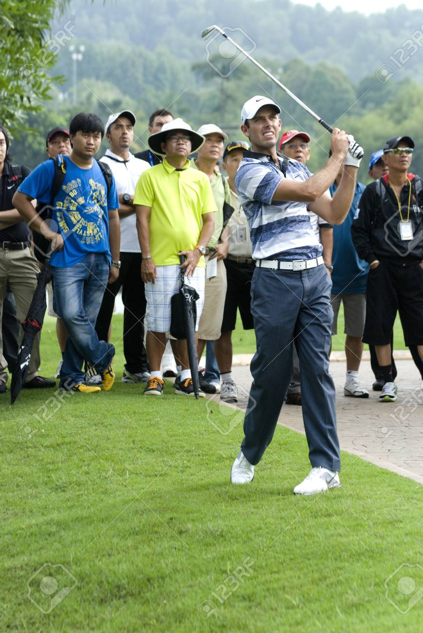 KUALA LUMPUR, MALAYSIA - APRIL 12: Charl Schwartzel of South Africa hits shot in the 13th holes during 1st round of Maybank Malaysian Open 2012 at Kuala Lumpur Golf & Country Club on Thursday, April 12, 2012 Stock Photo - 13257930