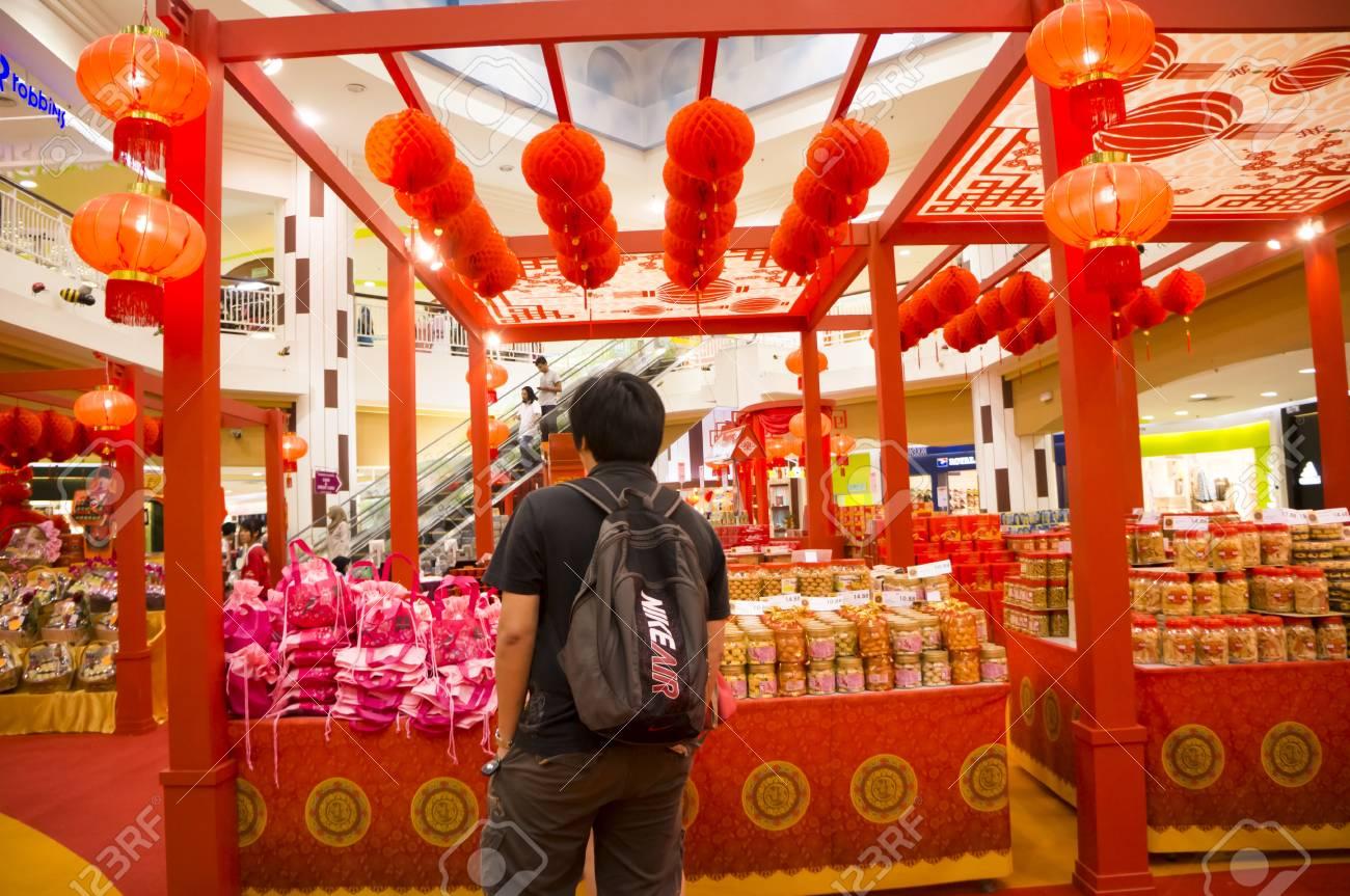 KUALA LUMPUR - JAN 14: A young man looks for stuff to celebrate Chinese New Year in Kuala Lumpur, Malaysia on January 14, 2013.  Stock Photo - 17403267