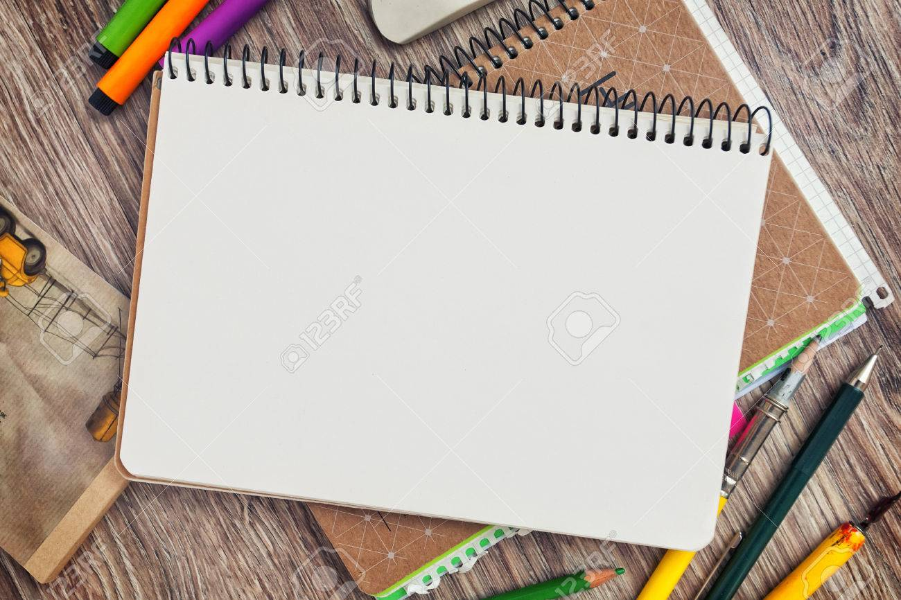 Notebook template mock up on a wooden table for artwork. View from above - 44222509