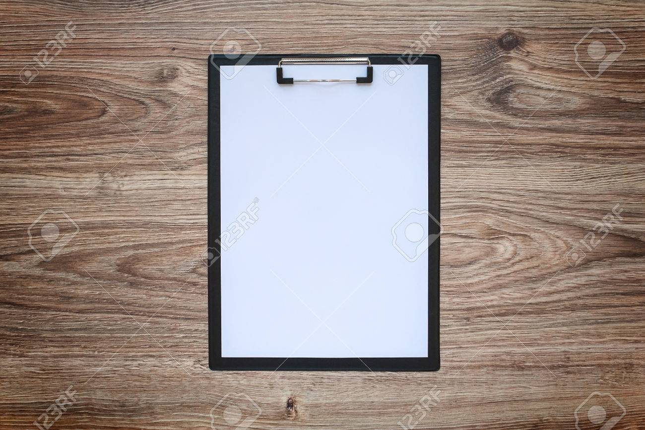 Blank white paper sheet A4 on clipboard on wooden background. Blackout frame. Top view - 58454734