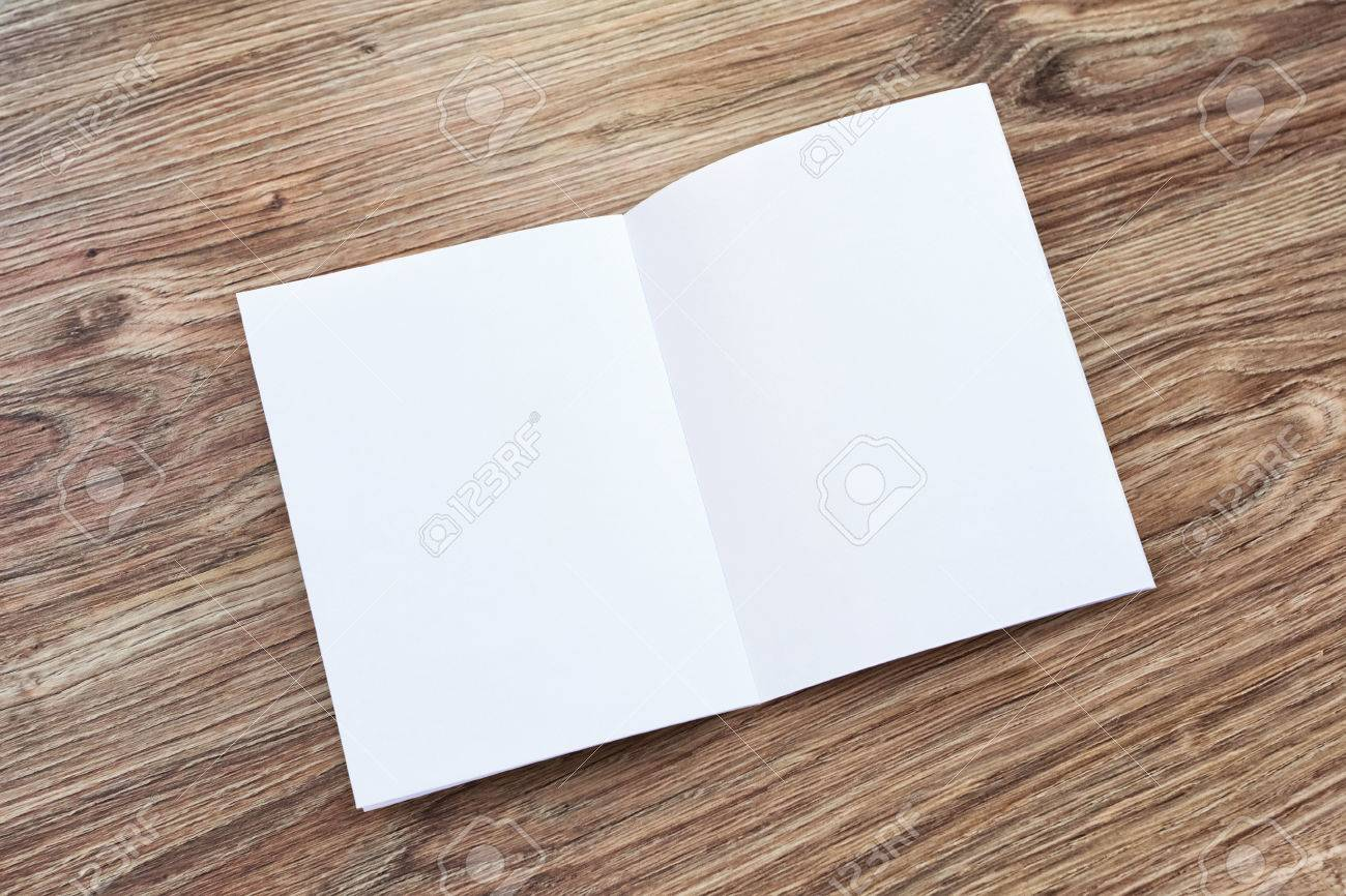 Open brochure, magazine on a wooden desk. Top view. Template to your design. - 68096790
