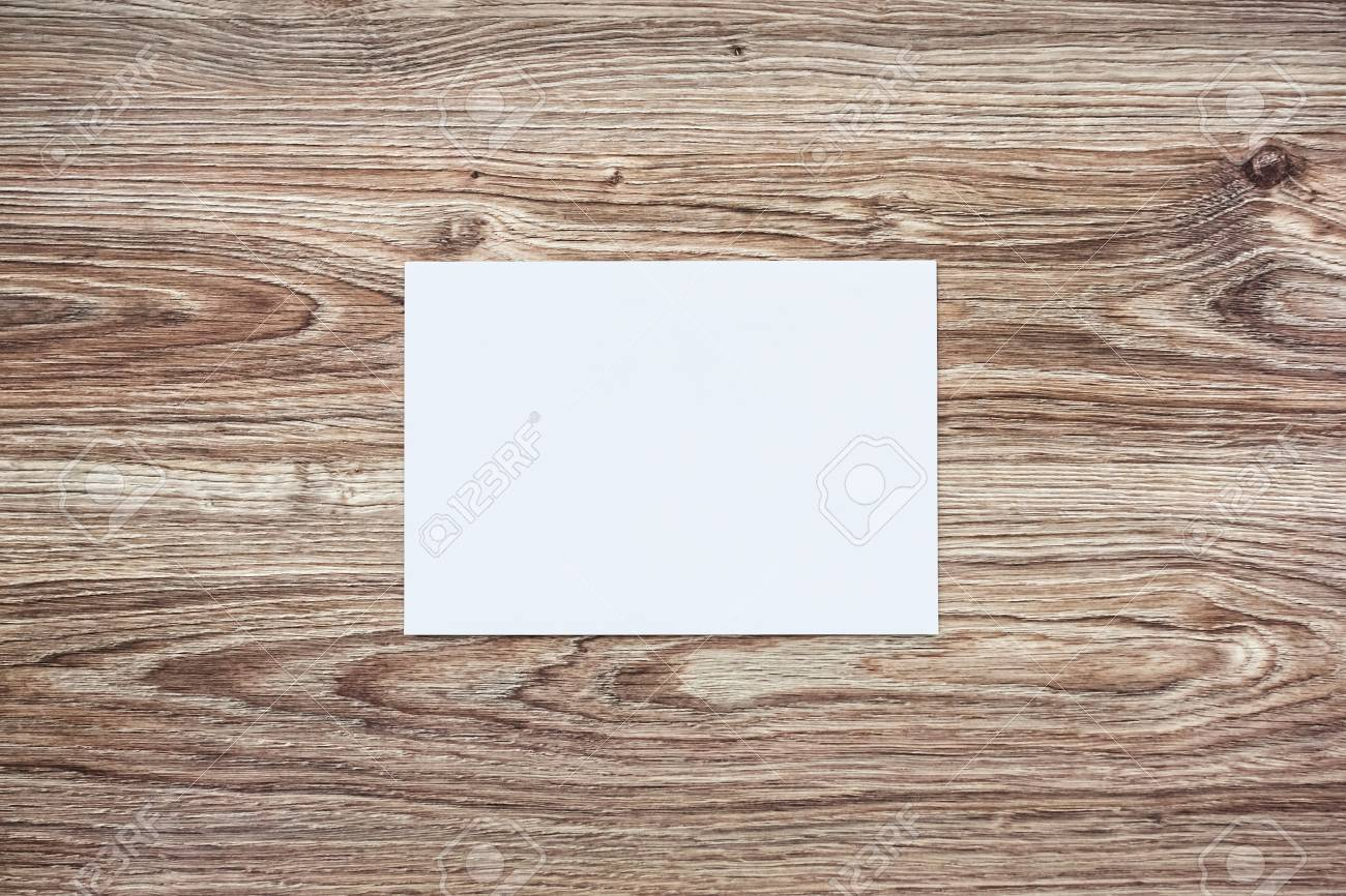 Blank white envelope on wooden background. Template for your design. Mockup object - 85472579