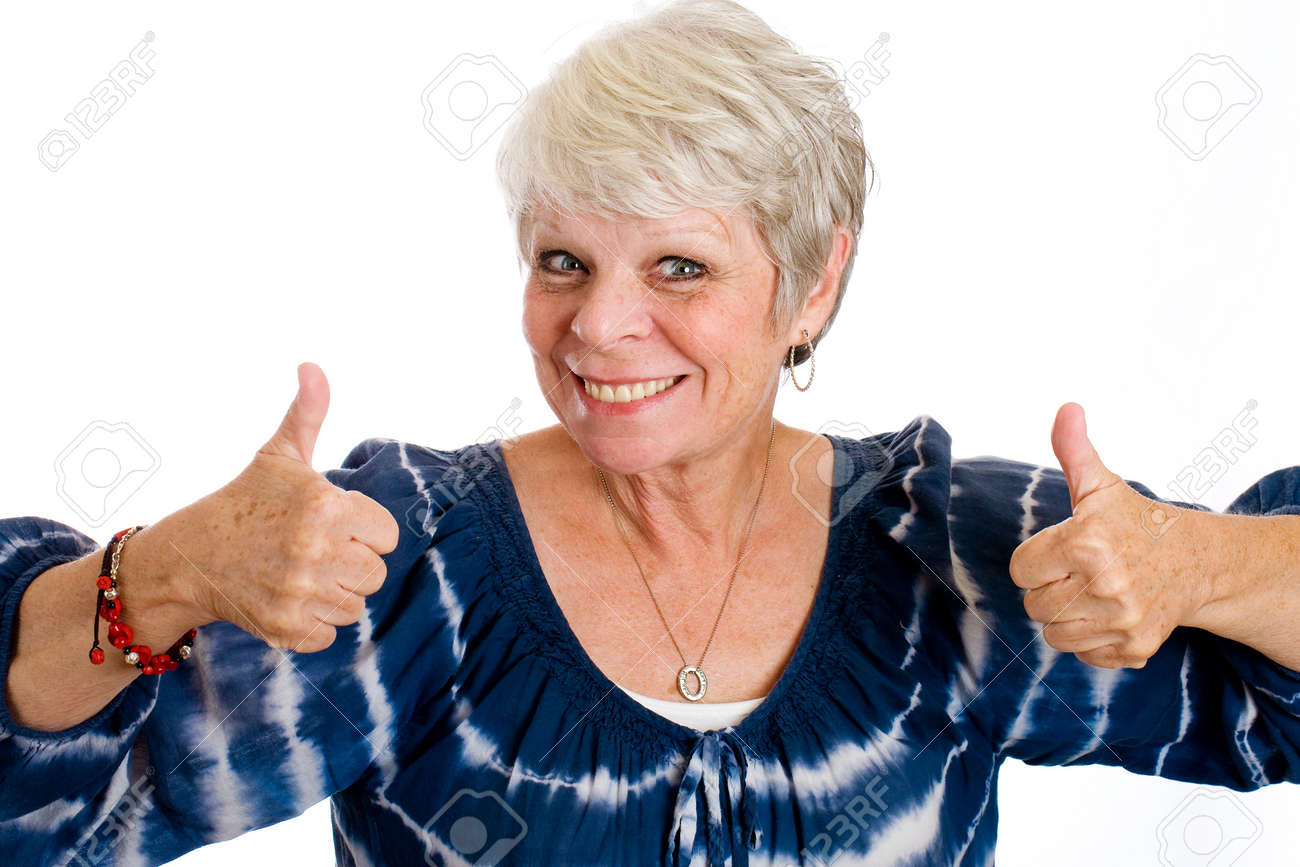 happy mature woman giving two thumbs up stock photo, picture and