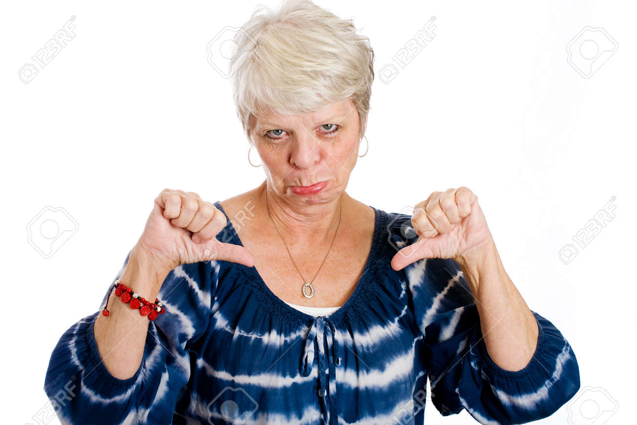 sad, mature woman giving two thumbs down stock photo, picture and