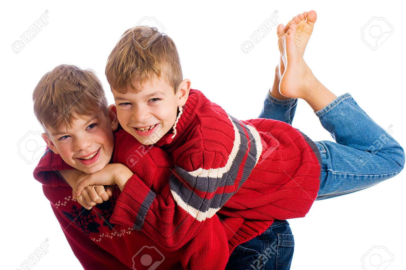 Two Cute Young Boys Wearing Red Sweaters Stock Photo Picture And