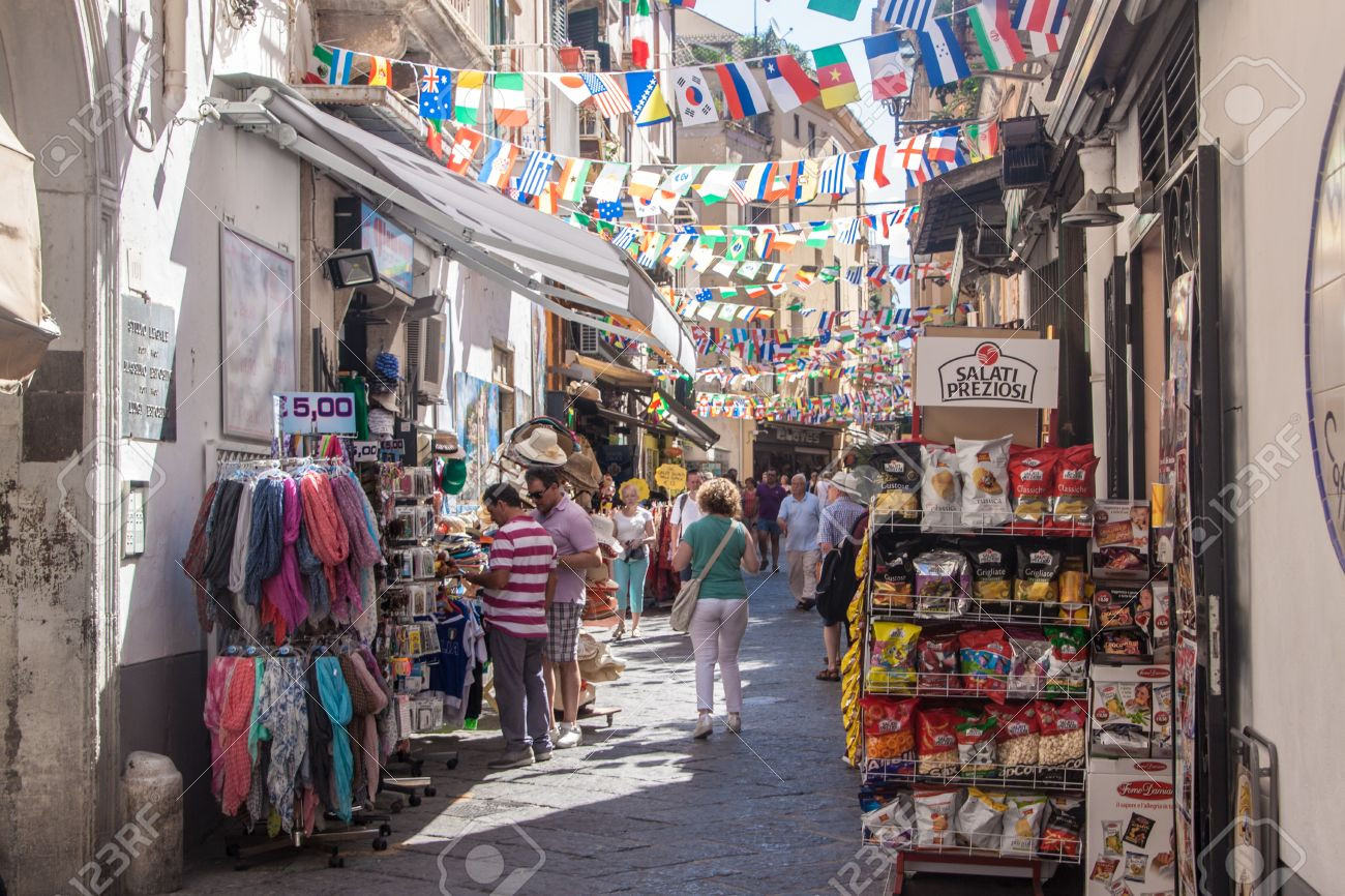 SORRENTO, ITALY - JUNE 29, 2014: People on a street in Sorrento. Sorrento is a small town in Campania, southern Italy. - 33578412