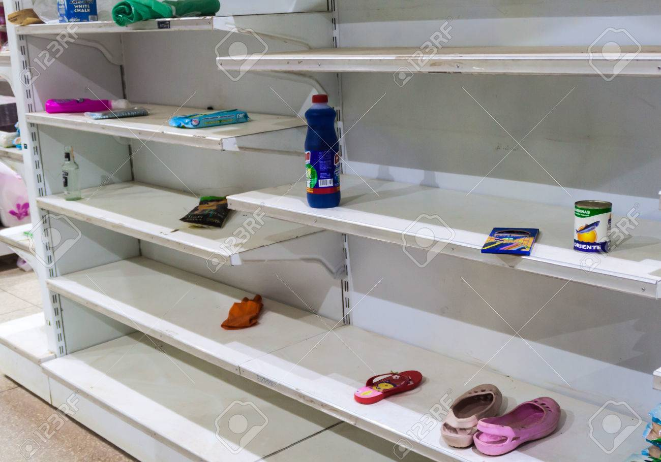 SANTA ELENA DE UAIREN, VENEZUELA - AUGUST 12, 2015: Empty shelves in a supermarket. Shortages of basic supplies are common in Venezuela. - 62235251