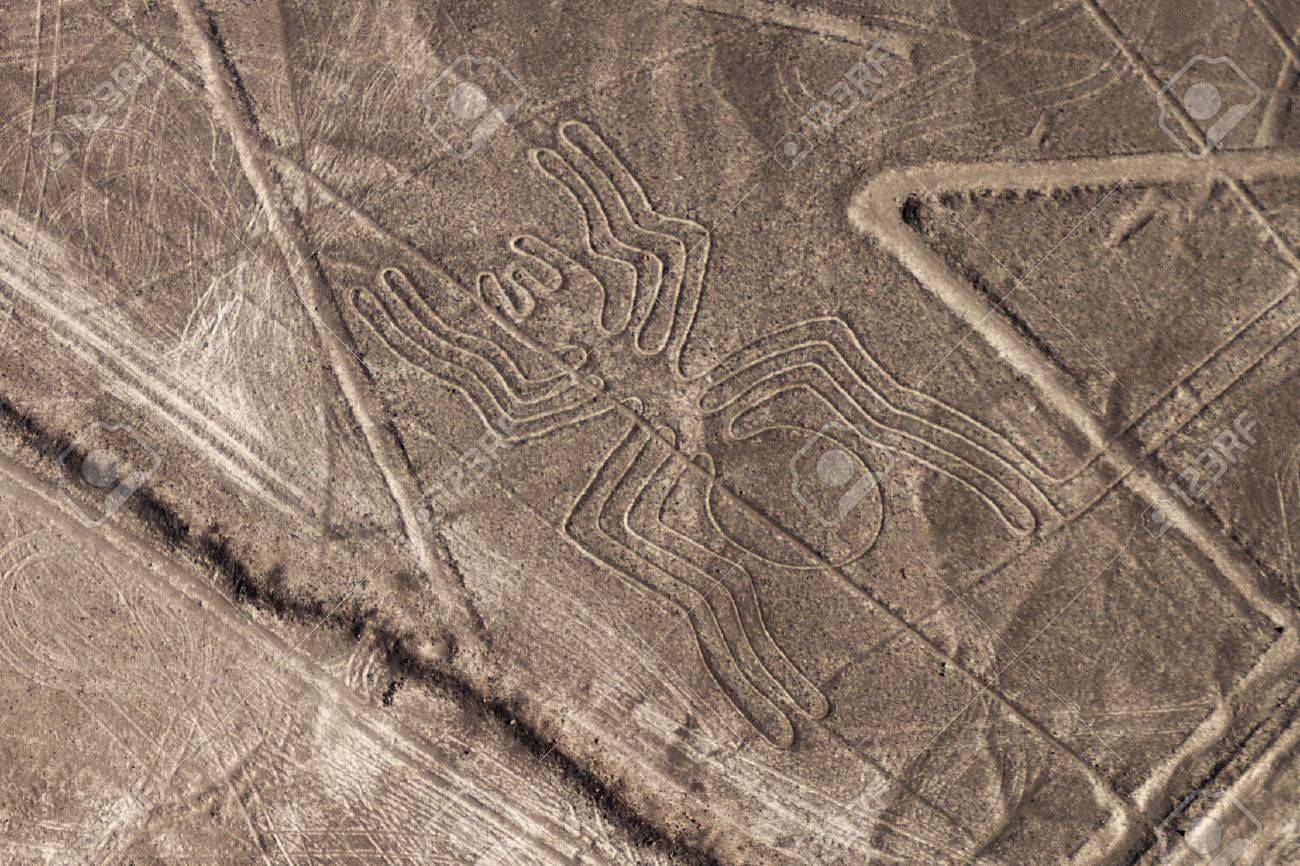 Aerial view of geoglyphs near Nazca - famous Nazca Lines, Peru. In the center, Spider figure is present. - 62132673