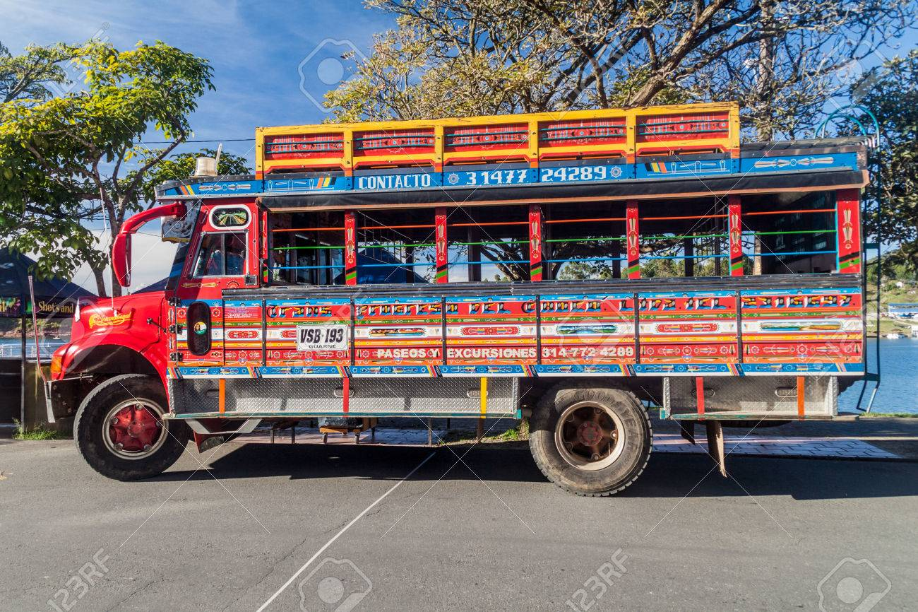 GUATAPE, COLOMBIA - SEPTEMBER 2, 2015: Colorful chiva buses are important part of rural public transport in Colombia. - 69670329