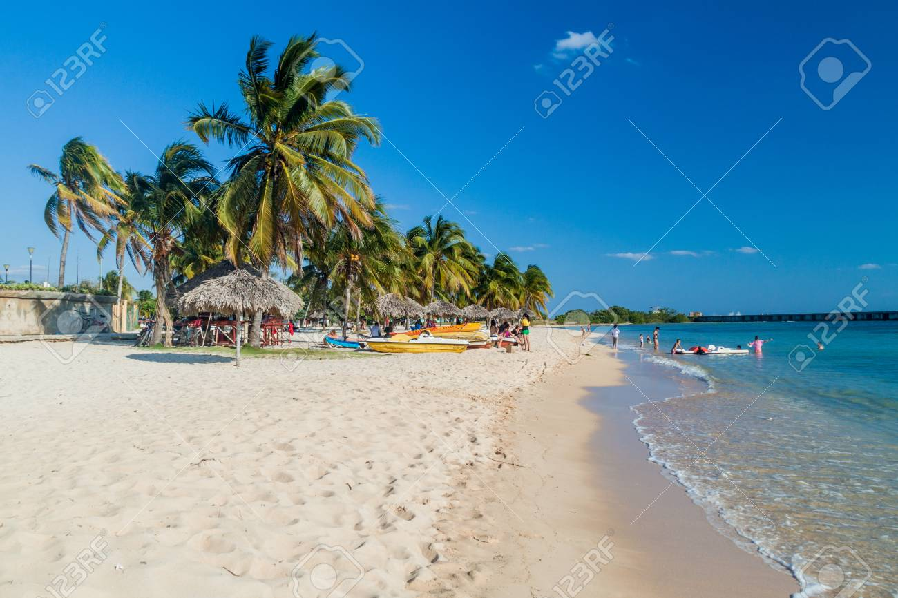 PLAYA GIRON, CUBA - FEB 14, 2016: Tourists at the beach Playa Giron, Cuba. This beach is famous for its role during the Bay of Pigs invasion. - 79334776