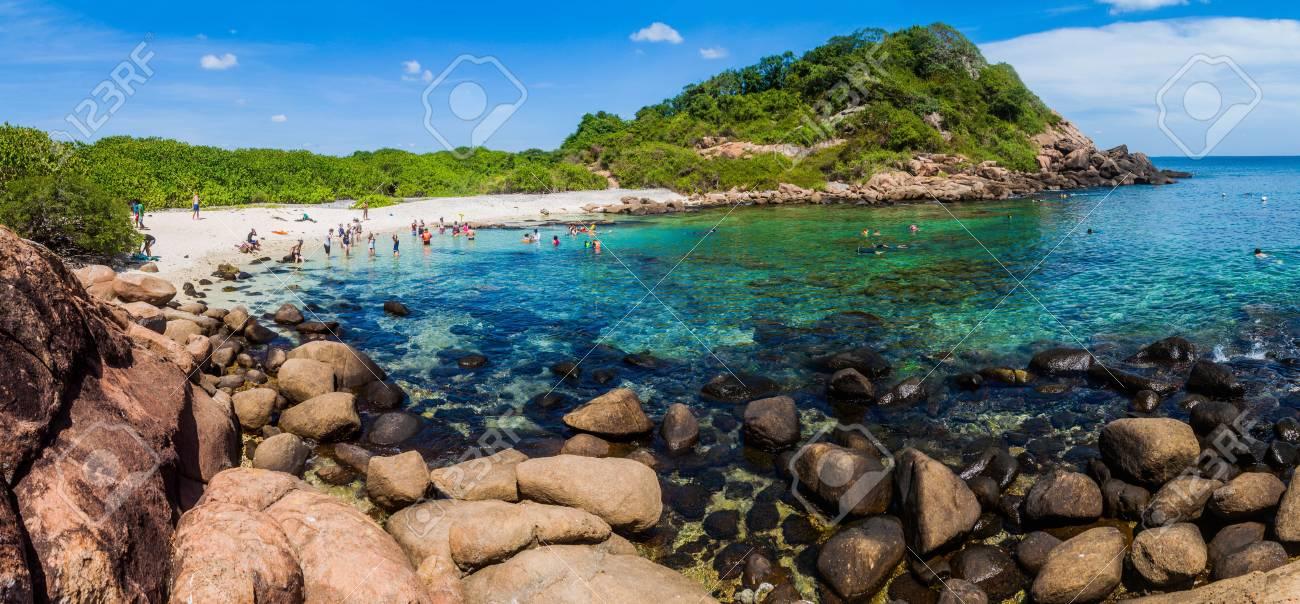 PIGEON ISLAND, SRI LANKA - JULY 25, 2016: People snorkel on a coral reef in Pigeon Island National Park near Nilaveli village in Sri Lanka. - 92809201