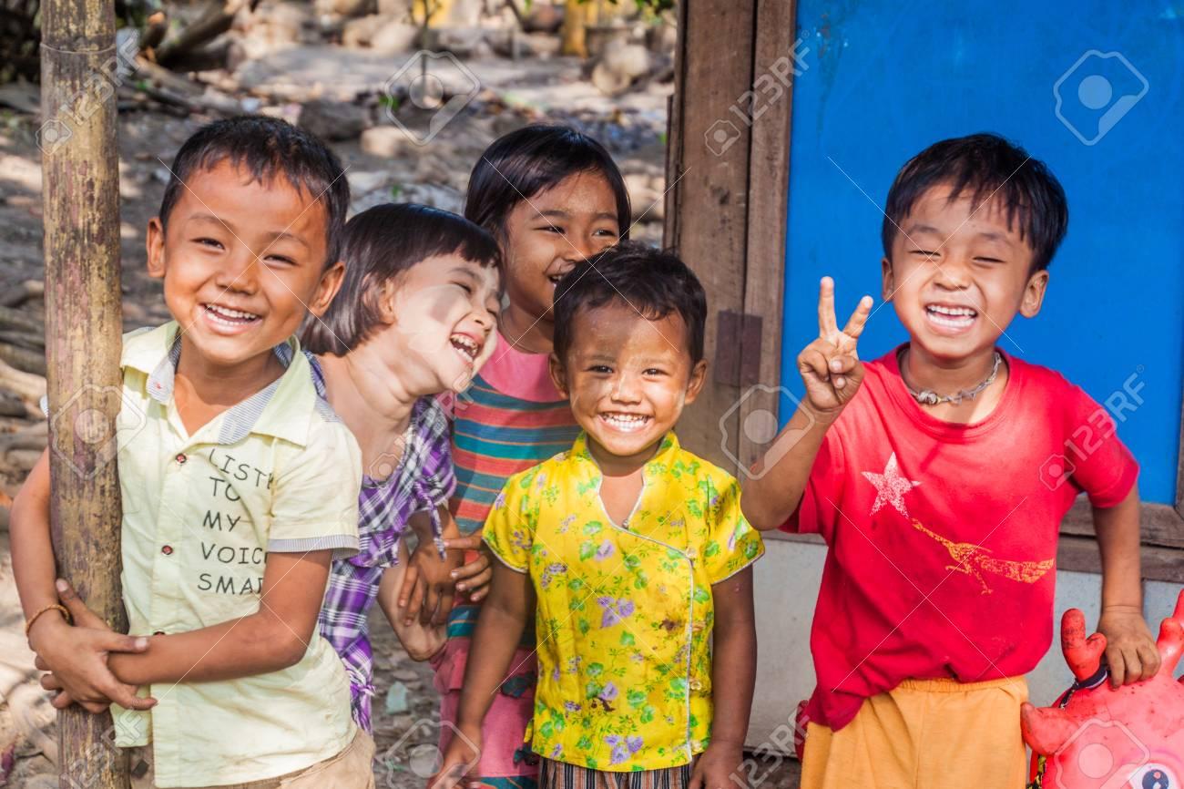 BAGO, MYANMAR - DECEMBER 10, 2016: Group of smiling local children in Bago town - 115463746
