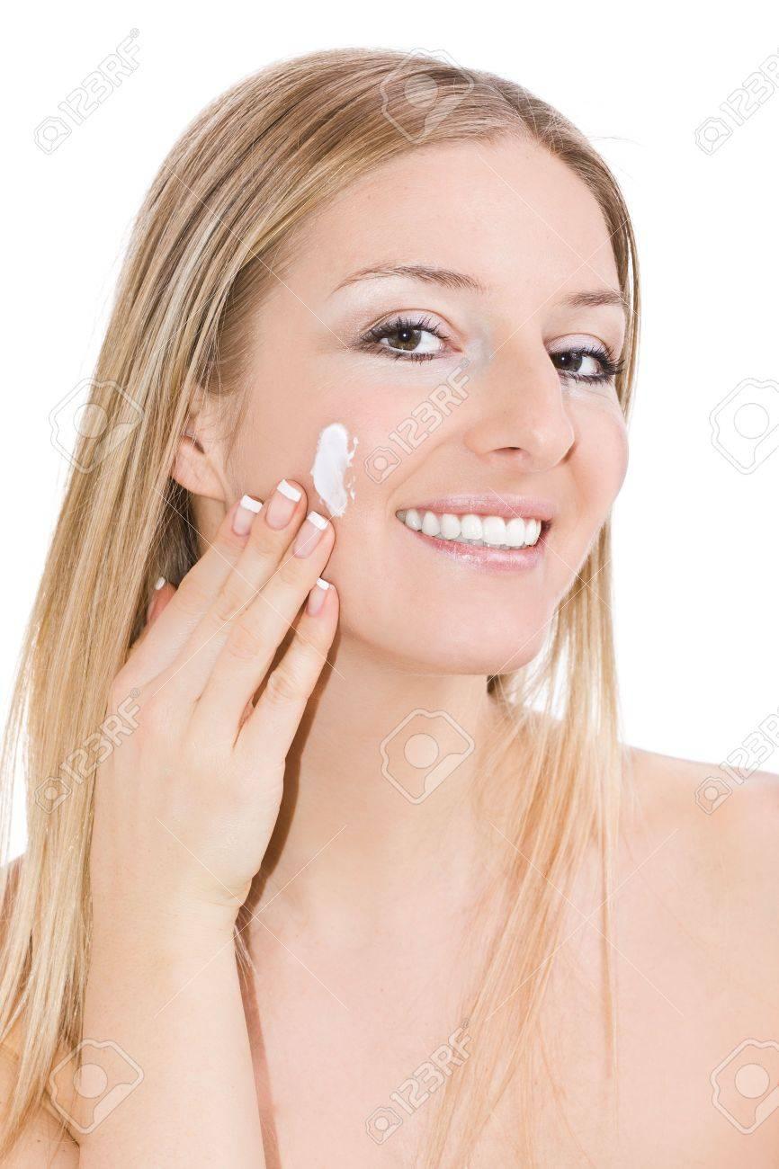 Woman creaming face Stock Photo - 6682623