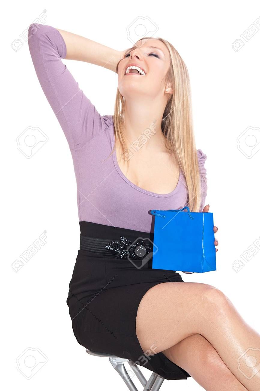 Caucasian sitting with gift bag Stock Photo - 6719822