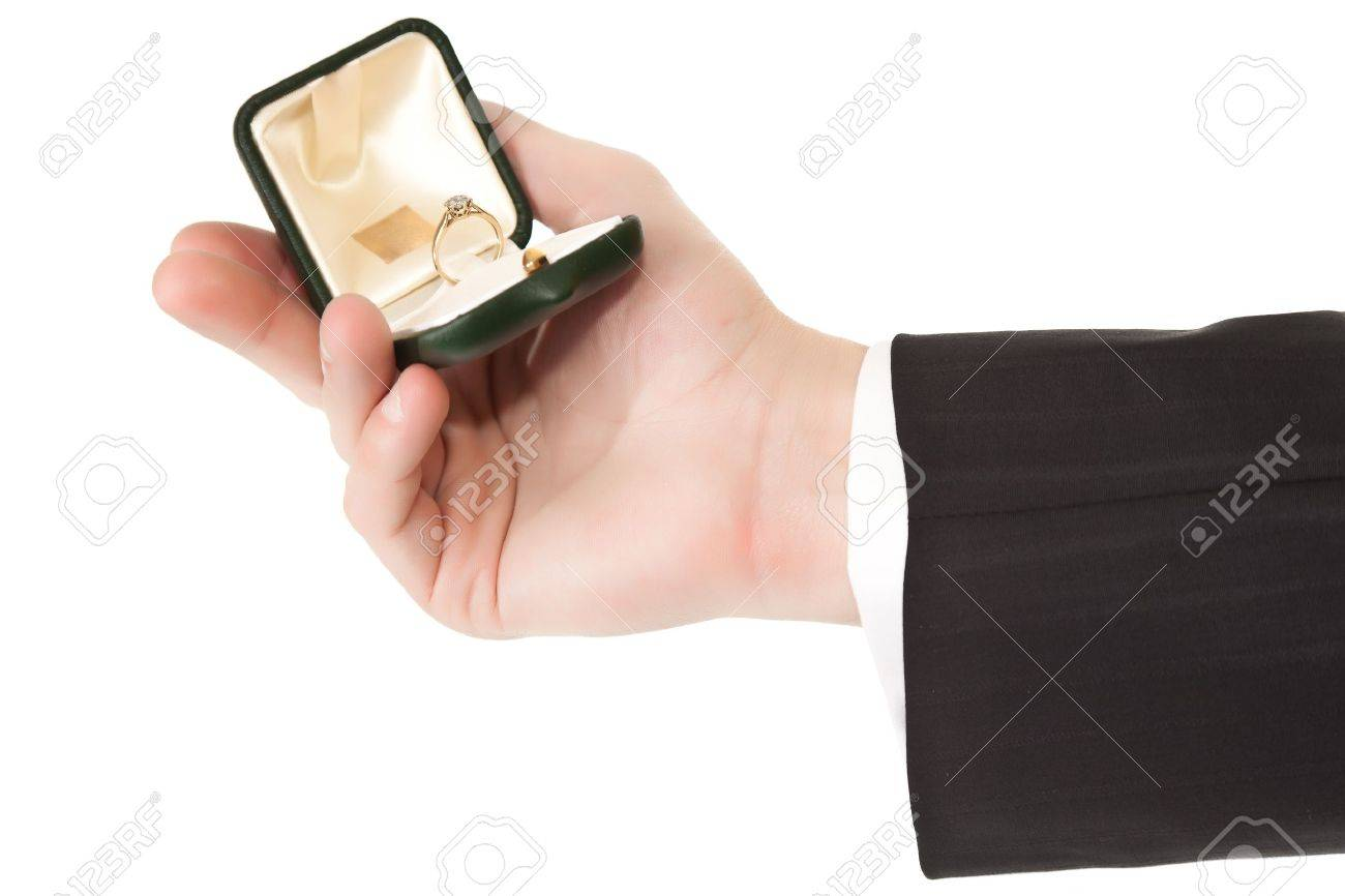 Man in suit holding engagement ring on white isolated background Stock Photo - 7779530